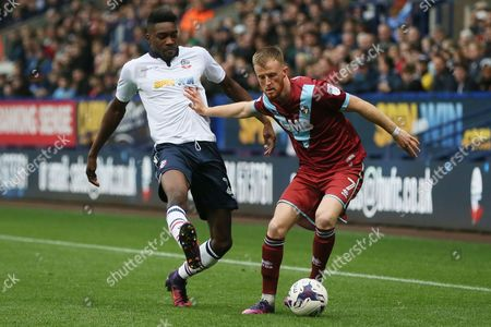Sammy Ameobi of Bolton Wanderers and Sam Kelly of Port Vale during the Sky Bet League One match between Bolton Wanderers and Port Vale played at the Macron Stadium, Bolton on 29th October 2016