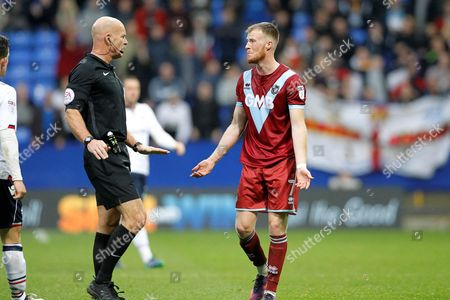 Port Vale's Sam Kelly (7) pleads his innocence after committing a foul during the EFL Sky Bet League 1 match between Bolton Wanderers and Port Vale at the Macron Stadium, Bolton