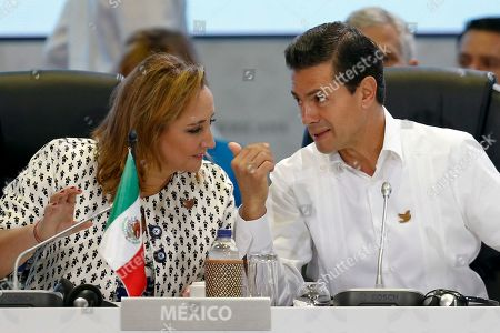 Enrique Pe'a Nieto, Claudia Ruiz Massieu Mexico's President Enrique Peña Nieto, right, talks to Mexico's Foreign Affairs Minister Claudia Ruiz Massieu during the opening ceremony of the 25th Ibero-American Summit in Cartagena, Colombia