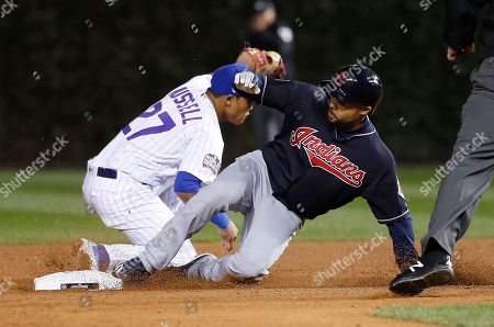 Cleveland Indians' Coco Crisp slides safely into second as Chicago Cubs shortstop Addison Russell (27) misses a tag during the seventh inning of Game 4 of the Major League Baseball World Series, in Chicago