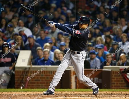 Cleveland Indians' Coco Crisp hits a double during the seventh inning of Game 4 of the Major League Baseball World Series against the Chicago Cubs, in Chicago