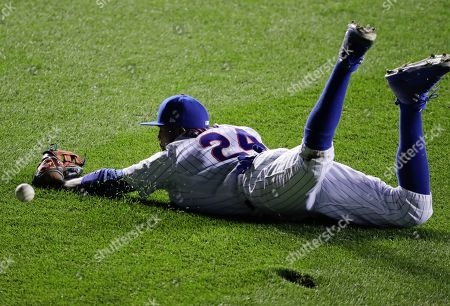 Chicago Cubs center fielder Dexter Fowler can't get a glove on a double by Cleveland Indians' Coco Crisp during the seventh inning of Game 4 of the Major League Baseball World Series, in Chicago