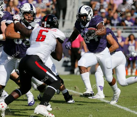 Stock Photo of Kris Williams, Trevorris Johnson Texas Tech defensive lineman Kris Williams (6) pressures as TCU running back Trevorris Johnson (24) carries the ball in the first half of an NCAA college football game, in Fort Worth, Texas