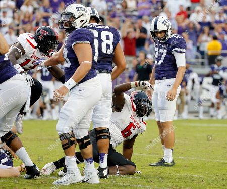 Stock Picture of Kris Williams, Brandon Hatfield Texas Tech defensive lineman Kris Williams (6) celebrates after TCU place kicker Brandon Hatfield (27) missed on a field goal attempt in double overtime of an NCAA college football game, in Fort Worth, Texas. Texas Tech won 27-24