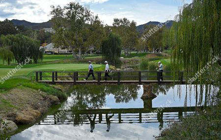 Colin Montgomerie, Jim Carter, Fred Funk Golfers, from left to right, Colin Montgomerie, of Scotland, Jim Carter and Fred Funk walk on to the second green during the second round of the PowerShares QQQ Championship golf tournament, at Sherwood Country Club in Thousand Oaks, Calif