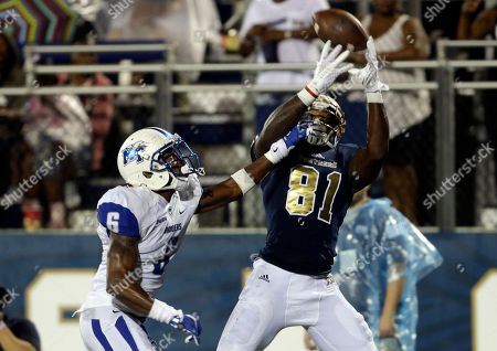 Florida International wide receiver Thomas Owens (81) scores a touchdown as Middle Tennessee cornerback Michael Minter (6) defends during the second half of an NCAA college football game, in Miami