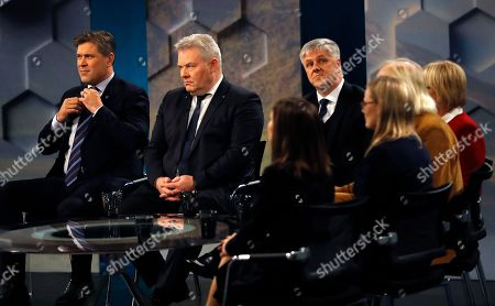 Bjarni Benediktsson of The Independence Party, left, sits beside Iceland Prime Minister Sigurdur Ingi Johannsson in a TV studio in Reykjavik, Iceland, . Parliamentary elections were held in Iceland on Saturday, with more than 250,000 voters entitled to elect 63 members of the Althing parliament