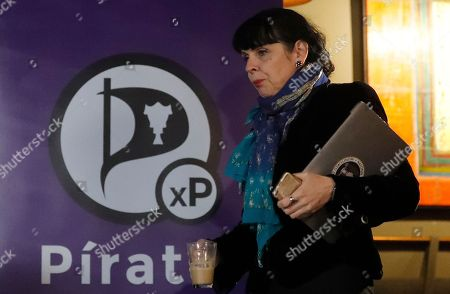 Birgitta Jonsdottir of the Pirater (Pirate) Party arrives for a press conference in Reykjavik, Iceland, . No party emerged Sunday with a clear mandate to form a government from Saturday's election, with the Pirate Party placed third, behind the Independence Party and the Left-Green movement
