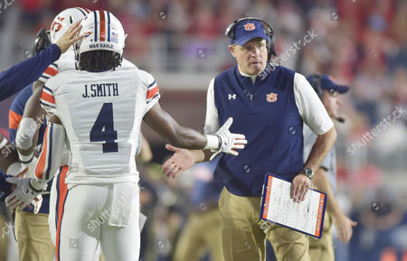 Auburn coach Gus Malzahn (right) welcomes receiver Jason Smith (4) back to the sideline following a touchdown during the third quarter of a NCAA college football game between the Auburn Tigers and Ole Miss Rebels at Vaught-Hemmingway Stadium in Oxford, MS. Auburn won 40-29