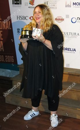 """Stock Picture of Mexican documentary film maker Maria Jose Cuevas poses with her award for Best Mexican Documentary, for """"Bellas de noche,"""" at the Morelia Film Festival in Morelia, Mexico"""
