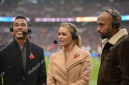 Thierry Henry waits to be interviewed by Laura Woods and Jason Bell during the NFL International Series match between Washington Redskins and Cincinnati Bengals played at Wembley Stadium, London on 30th October 2016