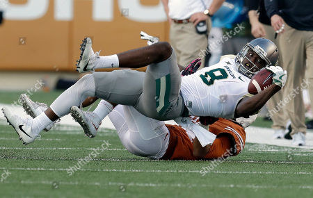 Shmael Zamora, John Bonney Baylor wide receiver Ishmael Zamora (8) is pulled down by Texas cornerback John Bonney (24) after a catch during the second half on a NCAA college football game, in Austin, Texas. Texas won 35-34