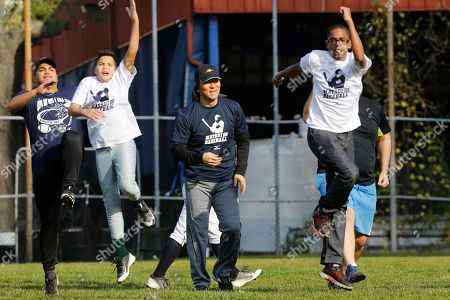 Former Major League Baseball player Hideki Matsui, center, watching young players exercise at his baseball clinic for 10 to 12-year-olds at the Kips Bay Boys and Girls club in the Bronx borough of New York