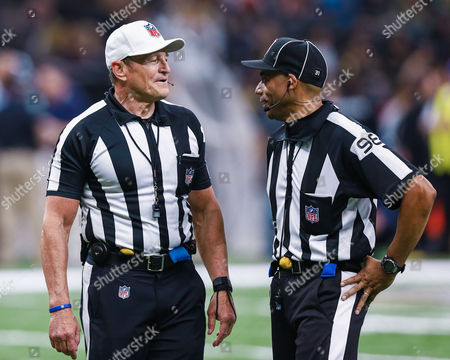referee Ed Hochuli (85) talking with head linesman Greg Bradley (98) during the game between the New Orleans Saints and the Seattle Seahawks at the Mercedes-Benz Superdome in New Orleans, LA. New Orleans Saints defeat the Seattle Seahawks 25-20