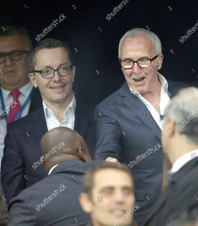 Frank McCourt, Jacques-Henri Eyraud, Basile Boli Owner of the Olympique de Marseille soccer club, Frank McCourt of USA, left, accompanied by Olympique Marseille President Jacques-Henri Eyraud, shakes hands with former Marseille's player Basile Boli, back, before the League One soccer match between Marseille and Bordeaux, at the Velodrome stadium, in Marseille, southern France