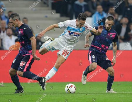 Florian Thauvin, Jeremy Toulalan, Diego Contento Marseille's forward Florian Thauvin, center is challenged by Bordeaux's midfielder Jeremy Toulalan, left, and Bordeaux's German defender Diego Contento, during the League One soccer match between Marseille and Bordeaux, at the Velodrome stadium, in Marseille, southern France