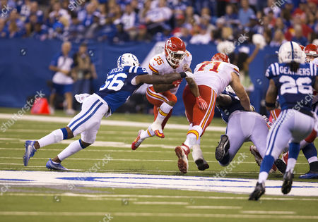 Kansas City Chiefs running back Charcandrick West (35) runs with the ball as Indianapolis Colts linebacker Akeem Ayers (56) attempts to make the tackle during NFL football game action between the Kansas City Chiefs and the Indianapolis Colts at Lucas Oil Stadium in Indianapolis, Indiana. Kansas City defeated Indianapolis 30-14