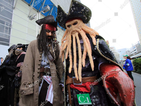 Participants wearing costumes take part in a Halloween parade