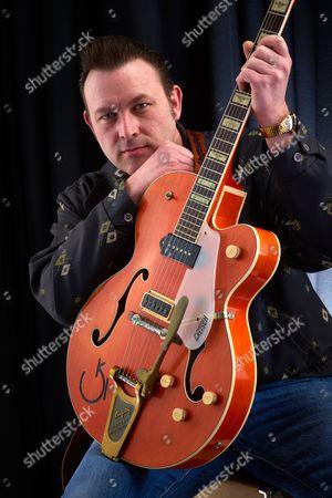 Stock Photo of Bath United Kingdom - March 7: Portrait Of English Rockabilly Guitarist Darrel Higham Photographed In Bath On March 7