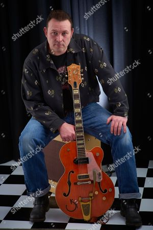 Stock Picture of Bath United Kingdom - March 7: Portrait Of English Rockabilly Guitarist Darrel Higham Photographed In Bath On March 7