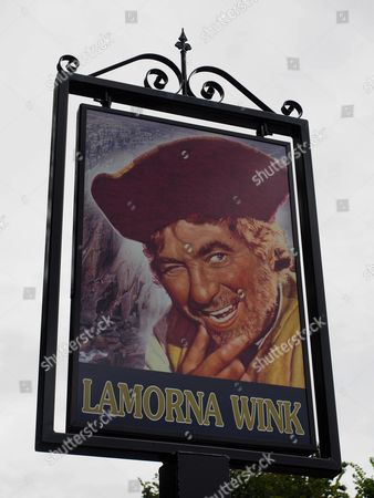 Lamorna Wink pub Lamorna Cornwall, UK carries an image of famous pirate actor Robert Newton who was born in the village and where he had his ashes scatted in the cove in 1956 after he died.