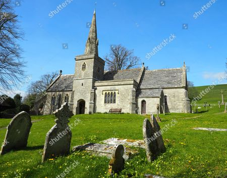 Little Bredy village in Dorset, Britain. The parish church of St Michael and All Angels