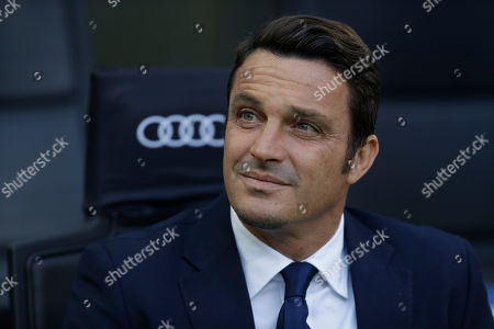 Pescara coach Massimo Oddo looks on sitting on the bench prior to the start of a Serie A soccer match between AC Milan and Pescara, at the San Siro stadium in Milan, Italy