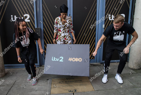 Niomi McLean-Daley, AKA Ms Dynamite watches as her 'Paving the Way' paving stone is unveiled