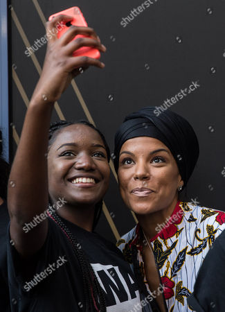 Niomi McLean-Daley, AKA Ms Dynamite taking a selfie with a student