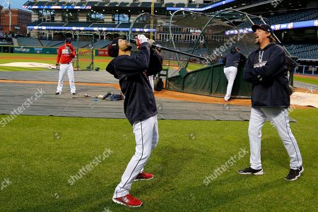 Stock Image of Coco Crisp Cleveland Indians' Coco Crisp, center, jokes around during an optional team workout at Progressive Field in preparation for baseball's upcoming World Series Game 6 against the Chicago Cubs Tuesday night in Cleveland