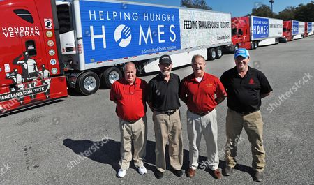 Smithfield's dedicated crew of Helping Hungry Homes truck drivers gather before send-off to distribute nearly one million servings of protein to eight U.S. food banks. From left: Fred Matthews, Carl Greene, Albert Tante, and Wes Cousins on in Smithfield, VA