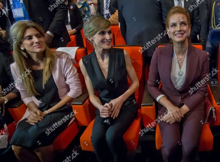 Jordan's Princess Dina Mired, left, Spain's Queen Letizia, center, and Morocco's Princess Lalla Salma, wife of King Mohammed VI, left, smiles as they await French President Francois Hollande at the Word Cancer Congress in Paris