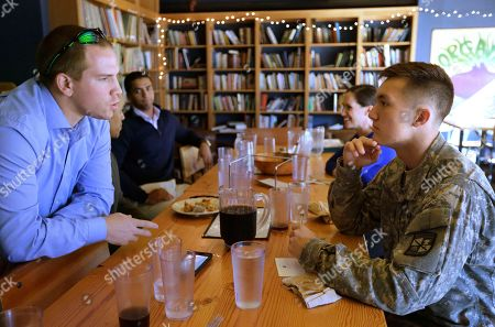 Stock Image of U.S. Army reservist and Brown University student Evan Stern, of Oradell, N.J., left, speaks with Brown University student and ROTC cadet William Summers, of Wailuku, Hawaii, right, during a luncheon at a pizza restaurant near the school's campus, in Providence, R.I. The luncheon was hosted by the university to make veterans more welcome on campus. Ivy League schools seek to step up recruitment of veterans, who are hugely underrepresented when compared with state schools