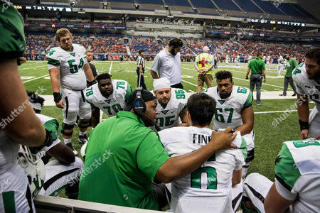 th, .North Texas Mean Green quarterback Mason Fine (6) is comforted by Offensive Line Coordinator Brad Davis on the sidelines during an NCAA College football game between the North Texas Mean Green Eagles vs University Texas San Antonio Roadrunners at the Alamodome Stadium in San Antonio, Texas