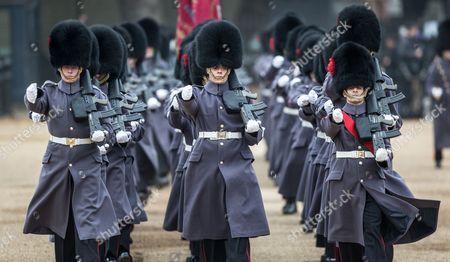 Guardsmen of the Coldstream guards march onto horse guards on the first day of state visit to the UK of The President of Colombia Juan Manuel Santos Calderon and his wife Maria Clemencia Rodriguez de Santos