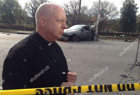 """The Rev. Mike Murphy who heard the crash from his room in the rectory of nearby St. Joseph's Monastery speaks to a reporter, in Baltimore. """"It was fast,"""" he said. """"It was like one loud thump. A school bus blocks away from its first stop Tuesday morning rear-ended a car, hit the entrance to a cemetery and then veered into an oncoming commuter bus in a crash that killed at least six people and injured 10, authorities said"""