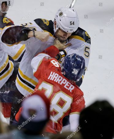 Shane Harper, Adam McQuaid Boston Bruins defenseman Adam McQuaid (54) and Florida Panthers right wing Shane Harper (38) fight during the third period of an NHL hockey game, in Sunrise, Fla. The Bruins defeated the Panthers 2-1