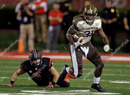 Stock Image of Zack Ryan, Jarvion Franklin Western Michigan running back Jarvion Franklin (31) breaks away from Ball State linebacker Zack Ryan (2) during the first half of an NCAA college football game in Muncie, Ind