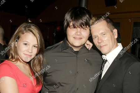 Kevin Bacon (far right) with daughter Sosie and son Travis