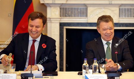 Juan Manuel Santos, Greg Hands Colombia's President Juan Manuel Santos, right, laughs with Greg Hands, Britain's minister of State for Trade and Investment, during a business meeting at Buckingham Palace in London, . This year's Nobel Peace Prize laureate Santos and his wife Maria Clemencia Rodriguez are on a three-day state visit to Britain