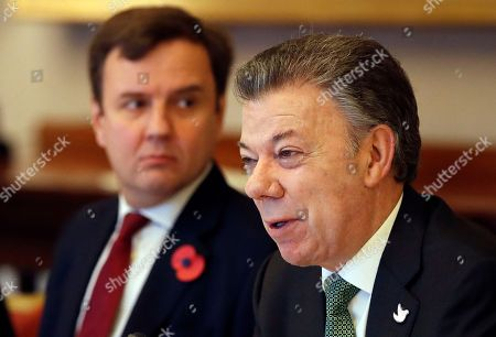 Juan Manuel Santos, Greg Hands Colombia's President Juan Manuel Santos, right, sits with Greg Hands, Britain's minister of State for Trade and Investment, during a business meeting at Buckingham Palace in London, . This year's Nobel Peace Prize laureate Santos and his wife Maria Clemencia Rodriguez are on a three-day state visit to Britain
