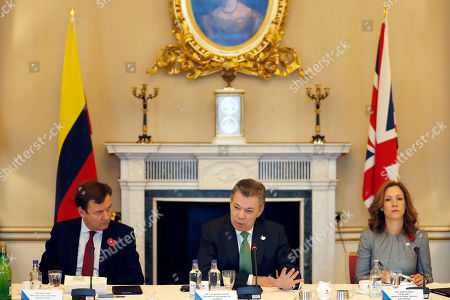 Juan Manuel Santos, Greg Hands, Maria Claudia Colombia's President Juan Manuel Santos, center, sits with Greg Hands, Britain's Minister of State for Trade and Investment, left, and Maria Claudia Lacouture, Minister of Trade Industry and Tourism, right, during a business meeting at Buckingham Palace in London, . This year's Nobel Peace Prize laureate the President of Colombia Juan Manuel Santos and his wife Maria Clemencia Rodriguez are on a three day state visit to Britain