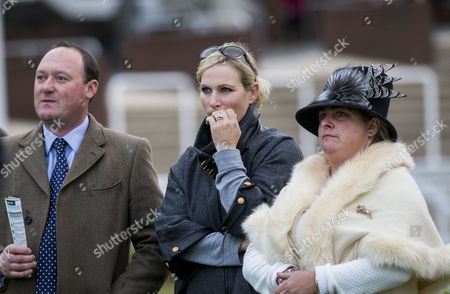 Stock Image of Zara Tindall watches her horse Somewhere To Be run in the White Christmas Parties Standard Open National Hunt Flat race, ridden by former boyfriend jockey Richard Johnson, with trainer Martin Keighley and his wife Belinda.