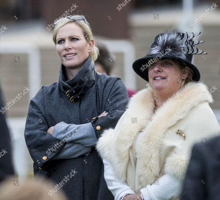 Zara Tindall watches her horse Somewhere To Be run in the White Christmas Parties Standard Open National Hunt Flat race, ridden by former boyfriend jockey Richard Johnson with Belinda Keighley the wife of trainer Martin Keighley.