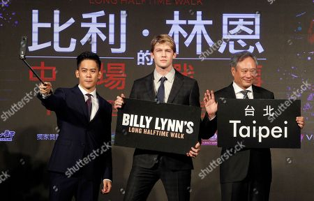 Ang Lee, Joe Alwyn, Mason Lee Taiwanese director Ang Lee, from right, U.S actor Joe Alwyn and Taiwanese-American actor Mason Lee pose for photographers during a media event to promote their new movie ''Billy Lynn's Long Halftime Walk'' in Taipei, Taiwan