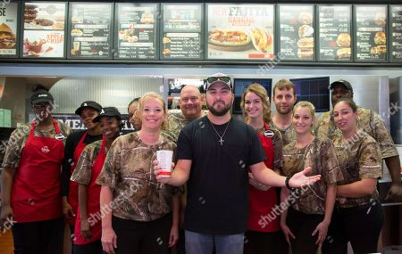 Country music artist Tyler Farr celebrates Arby's It's Meats Season hunting campaign with team members at Arby's on in Nashville, Tenn