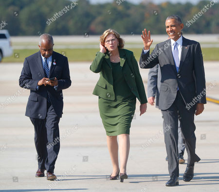 Stock Image of Barack Obama, Nancy McFarlane, Bill Bell President Barack Obama walks with Raleigh, N.C. Mayor Nancy McFarlane, and Durham, N.C. Mayor Bill Bell, across the tarmac to greet guests upon Obama's arrival on Air Force One at Raleigh-Durham International airport in Morrisville, NC., . Obama is in North Carolina to help turn out the vote for Democratic presidential candidate Hillary Clinton with a rally in Chapel Hill. It's the first of two visits Obama has planned this week to North Carolina