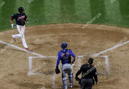 Stock Photo of Cleveland Indians' Coco Crisp scores on a hit by Carlos Santana during the third inning of Game 7 of the Major League Baseball World Series against the Chicago Cubs, in Cleveland