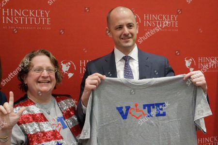 Evan McMullin Supporter Alison Greathouse, left, poses with independent presidential candidate Evan McMullin during a University of Utah candidate forum, in Salt Lake City. McMullin answered questions at the forum, as he attempts to fend off a new wave of critiques from Republican Donald Trump's supporters who are trying to prevent McMullin from winning what has become a toss-up state