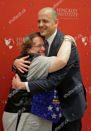 Evan McMullin Supporter Alison Greathouse, left, hugs independent presidential candidate Evan McMullin during a University of Utah candidate forum, in Salt Lake City. McMullin answered questions at the forum, as he attempts to fend off a new wave of critiques from Republican Donald Trump's supporters who are trying to prevent McMullin from winning what has become a toss-up state